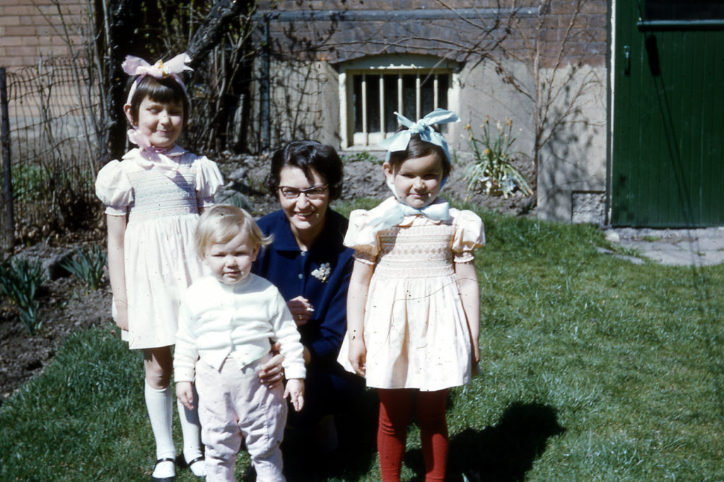 mother posing with three girls