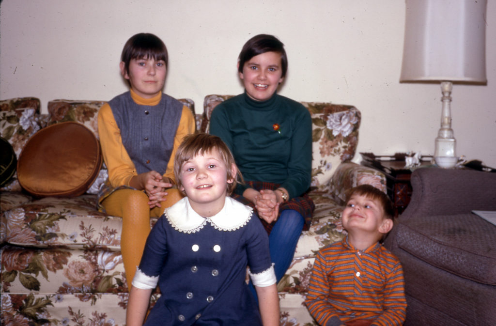 four kids posing on a couch