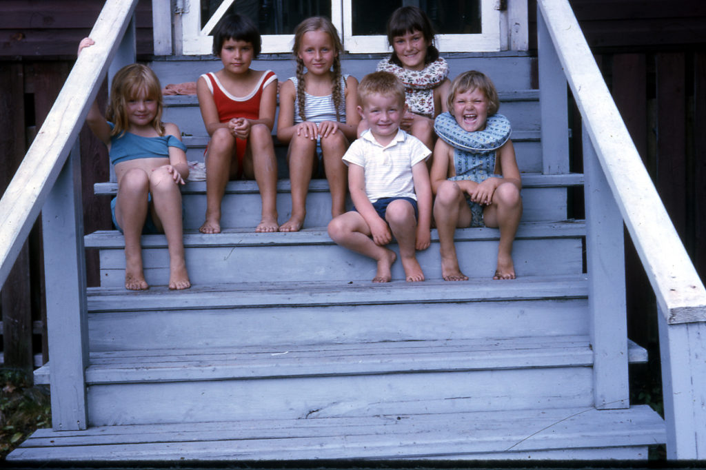 kids sitting on stairs with bathing suits on