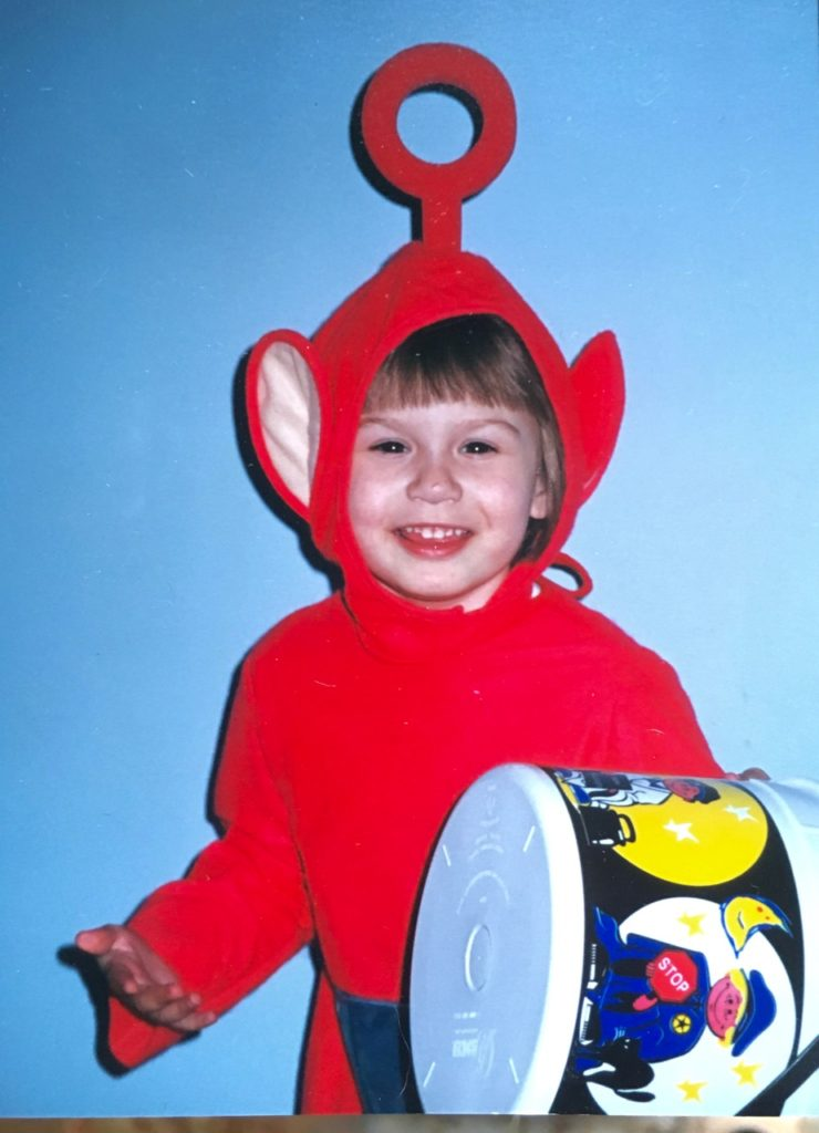 girl dressed up as Po the Teletubbie