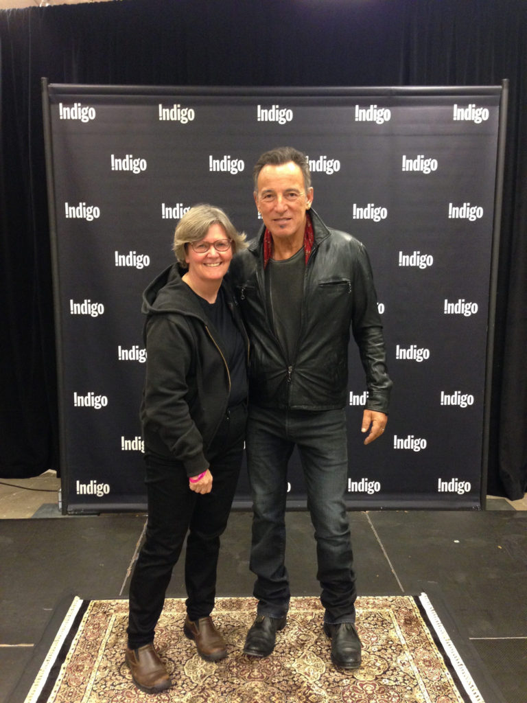 woman in black with bruce springsteen