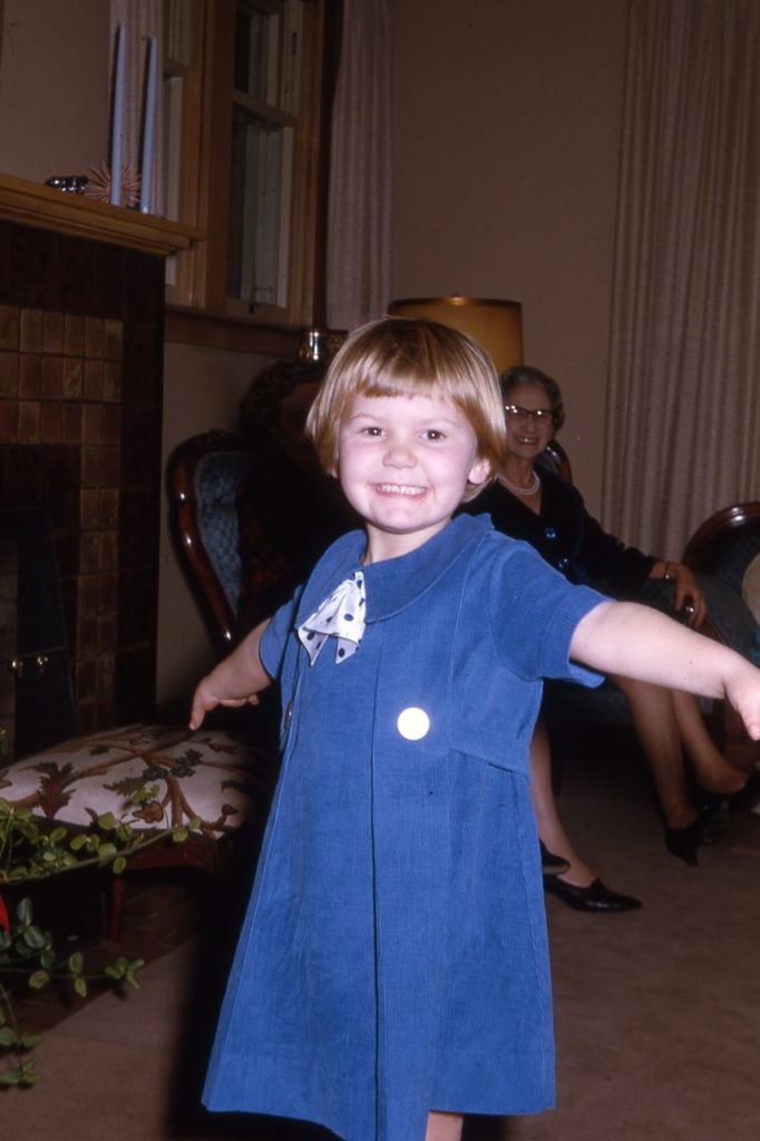 girls with pixie cut in blue dress