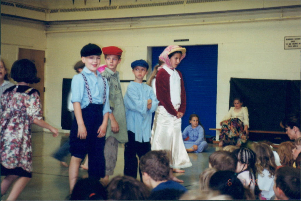 Little kids dressed up for a play