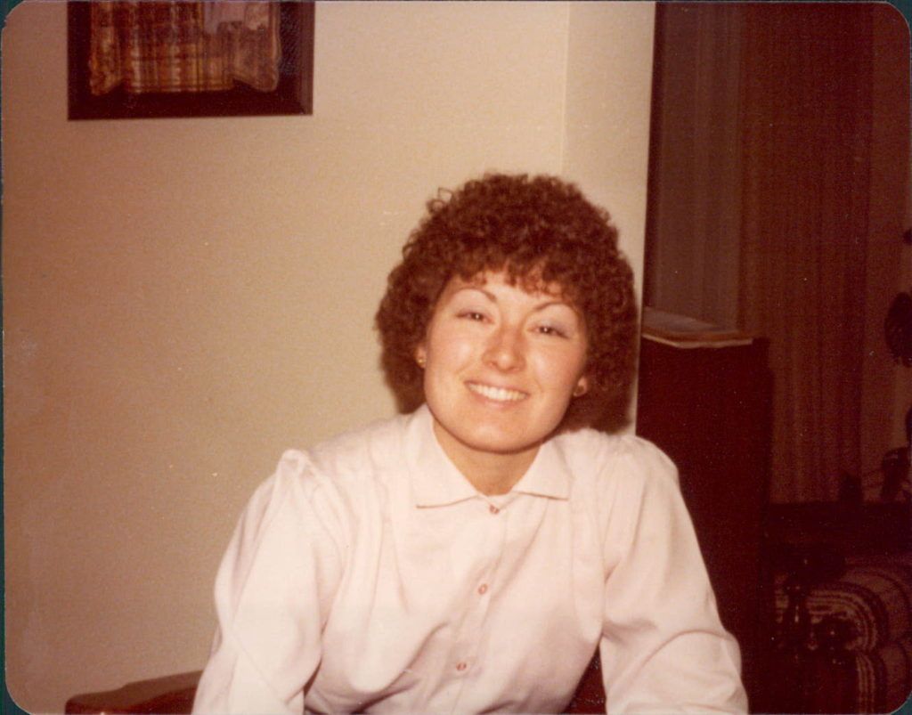 portrait of young woman with perm