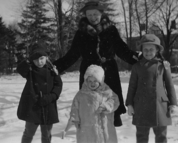 black and white picture of family in dress coats
